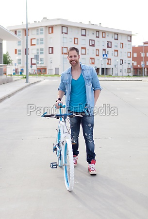 cool guy with a vintage bicycle