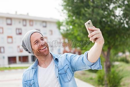 casual fashion guy taking a photo