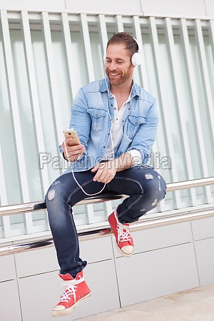 casual man in the street listening
