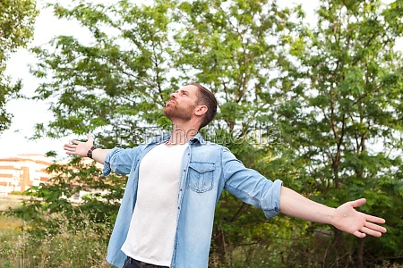 carefree and free man raising his