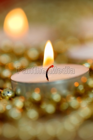 christmas candles with golden decoration