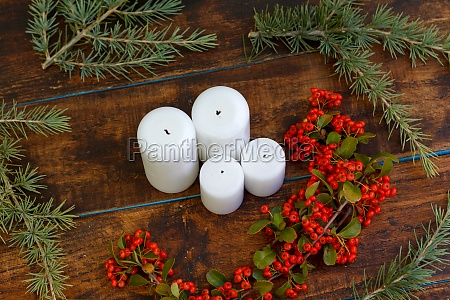 christmas candles with red berries