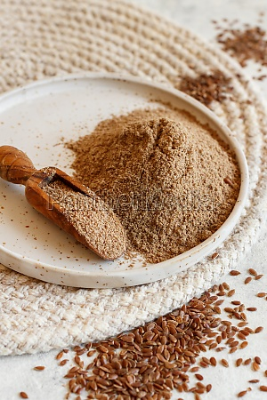 raw flax seeds flour in a