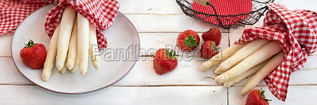 fresh asparagus and strawberries on vintage