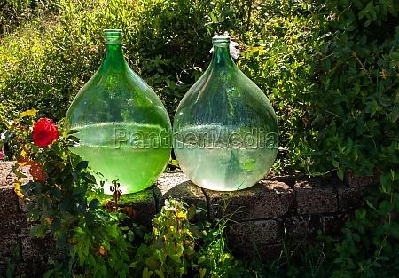 demijohn wine bottles at vineyard of