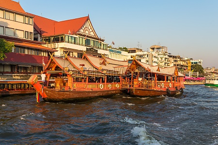 traditional rice barge built for gastronomy