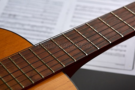 acoustic guitar music book on background