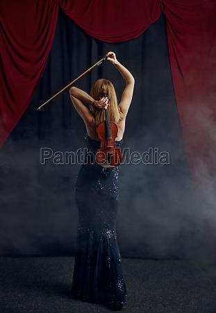 female violonist with violin virtuoso performance