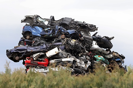stacked cars in the junkyard