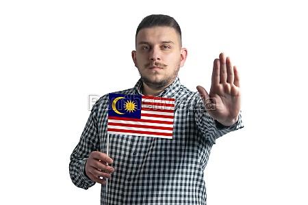 white guy holding a flag of