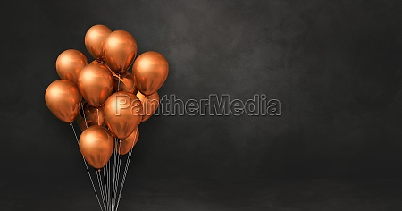 copper balloons bunch on a black