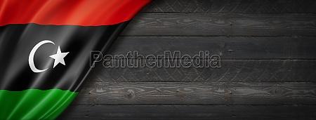 libyan flag on black wood wall