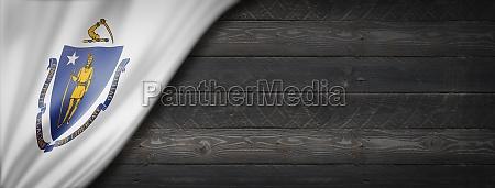 massachusetts flag on black wood wall