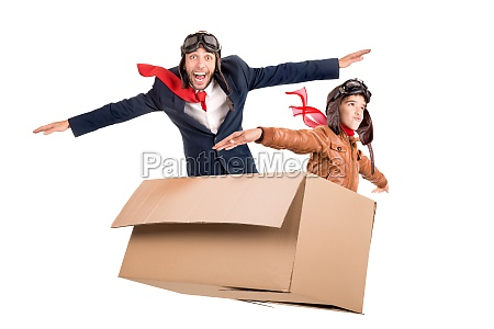 father and son in a cardboard