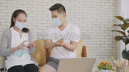 woman brings alcohol gel applying to