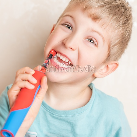 little child laugh and brushing her