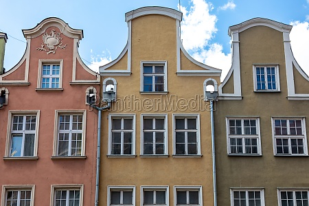 colorful facades of historic tenement houses
