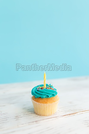 birthday greeting concept yellow candle on