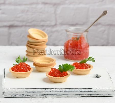 red caviar in a glass jar