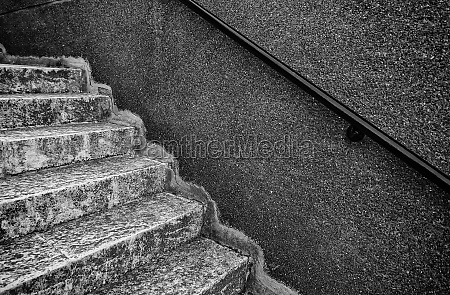 stone stairs with handrails