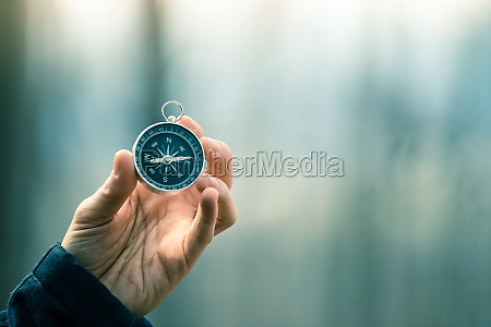 compass holding in the hand outdoor