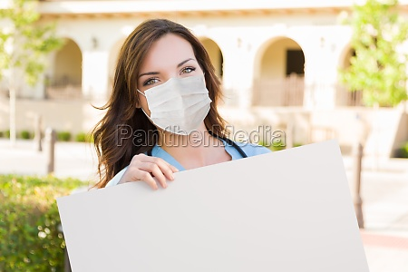 female doctor or nurse wearing protective