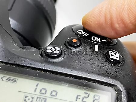 finger pressing the shutter button of