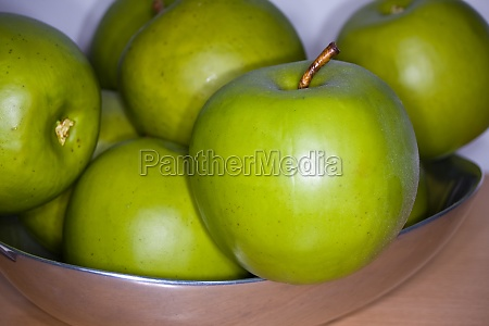 silver bowl of granny smith apples