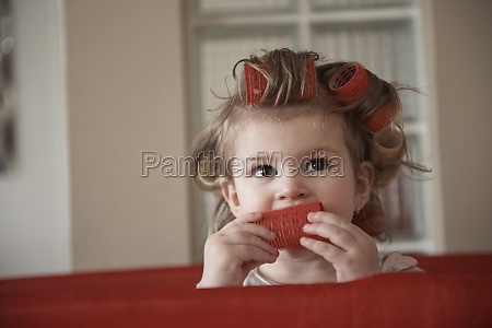 little baby girl with strange hairstyle