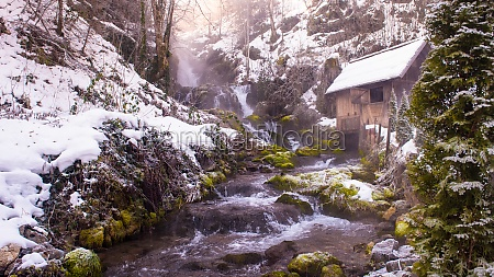 rural landscape with old watermill in