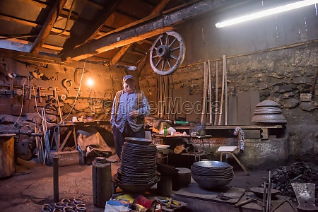 portrait of confident senior blacksmith