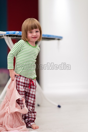 portrait of cute little girl playing