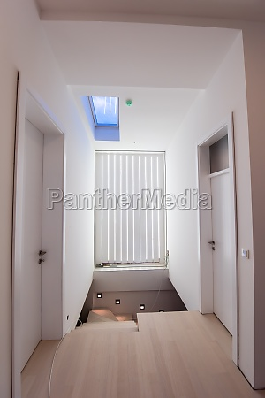 stylish interior with wooden stairway