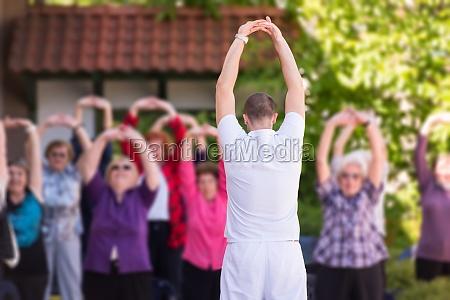 trainer training motivated active healthy senior