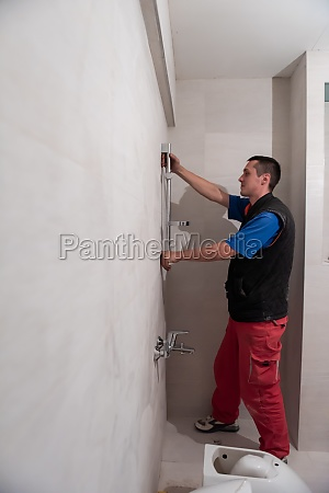 professional plumber working in a bathroom