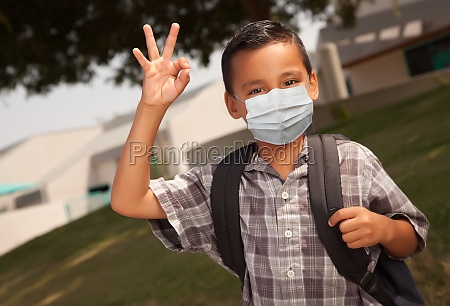 hispanic student boy wearing face mask