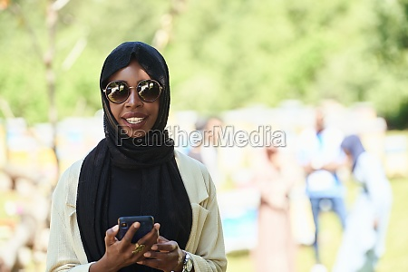 african woman using smartphone wearing