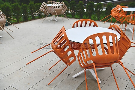 restaurant tables and chairs at outdoor