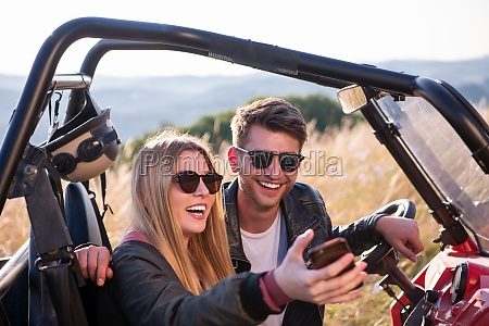 young couple taking selfie picture while