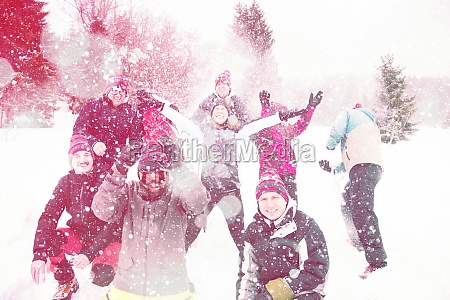 group of young people throwing snow