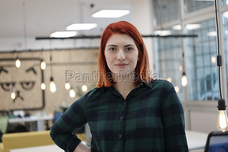 redhead woman at work in