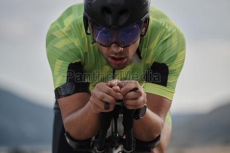 closeup of triathlon athlete riding bike