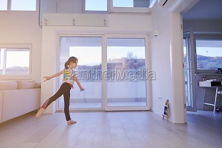 girl online education ballet class at