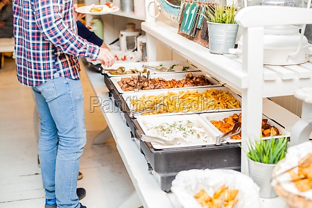 people catering food buffet eating party