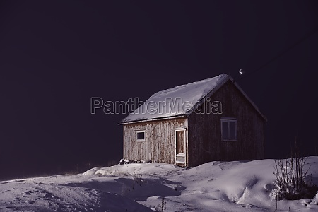 traditional norwegian fishermans cabins covered