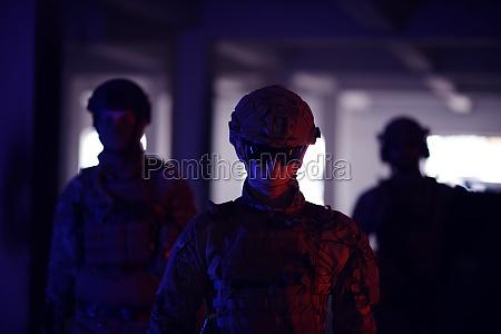 soldier squad team walking in urban