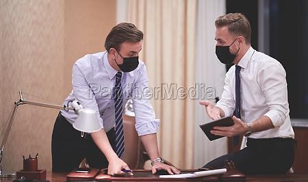 business people wearing crona virus protection