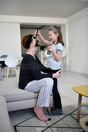 mother and daughter at home making