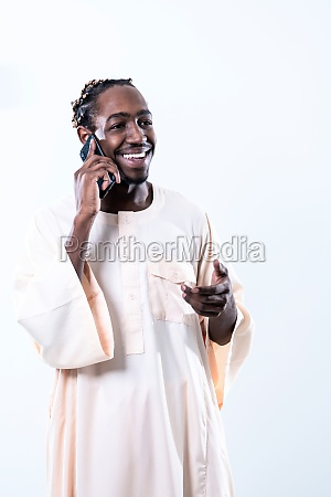 african man using smartphone