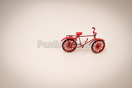 miniature figures of red bicycle